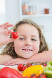 Girl holding cherry tomato