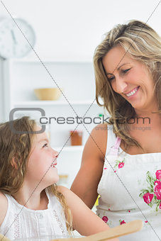 Mother smiling at her daughter