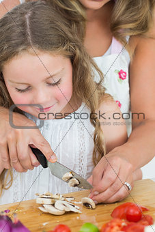 Daughter cutting mushrooms