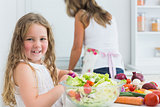 Girl preparing vegetable salad