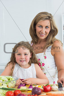 Daughter and mother looking directly into the camera