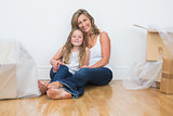 Daughter and mother sitting on the floor