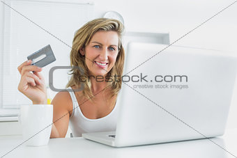 Woman using laptop for online shopping