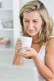 Smiling woman holding mug
