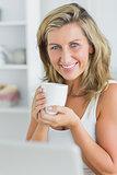 Happy woman holding mug