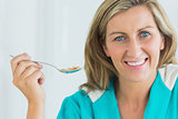 Woman holding spoon of cereal