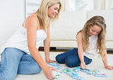 Mother and daughter doing a jigsaw