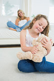 Smiling daughter with her teddy
