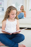 Daughter reading a book