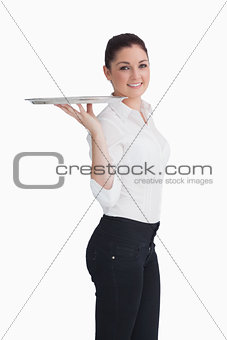 Waitress balancing silver tray