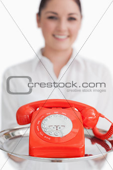 Close up of red telephone on tray