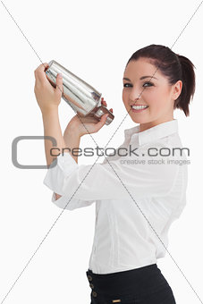Woman shaking cocktail