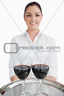 Close up of tray with glasses of wine