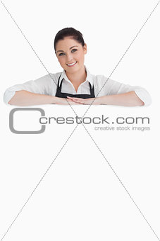 Cheerful woman resting on her arms