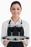 Waitress holding two glasses of wine
