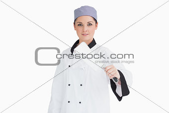 Cook holding a meat cleaver