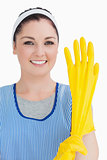 Cleaner woman wearing yellow gloves