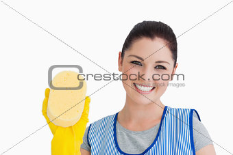 Cleaning woman showing a sponge