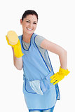 Cleaning woman presenting a sponge