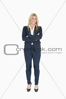 Smiling business woman crossing her arms