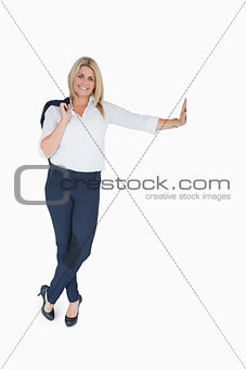 Business woman posing and holding her jacket