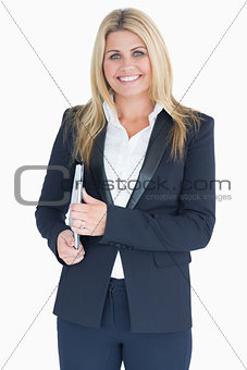Smiling business woman posing with a clipboard