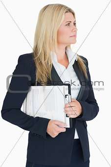Business woman looking away with a clipboard