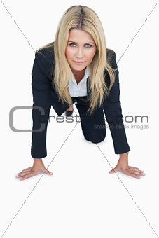 Business woman getting ready to race