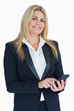 Cheerful business woman using her smartphone