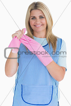 Cleaner woman removing pink gloves