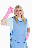 Cleaner woman making ok hand sign