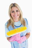 Cleaner woman holding a yellow broom