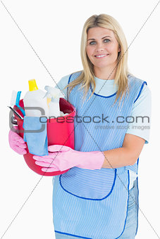 Cleaner woman holding a bucket