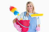 Cleaner holding a bucket with a broom