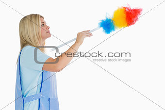 Cleaning woman using a feather duster