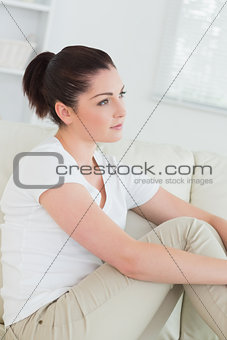 Thoughtful woman on the couch