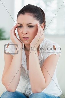 Stressed woman sitting on the couch