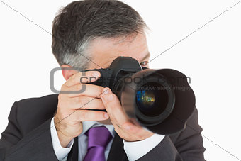 Businessman taking a photo