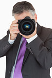Businessman using digital camera