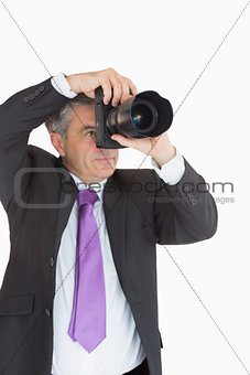 Man in suit taking picture