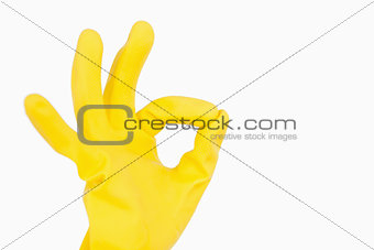 Hand in glove showing ok symbol