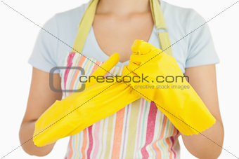 Woman taking off her rubber gloves