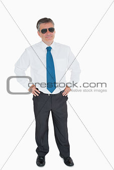 Smiling man with hands on hips