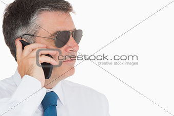 Man in suit and sunglasses on mobile phone
