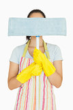 Young woman hiding behind mop