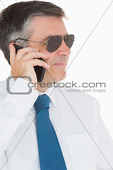 Smiling businessman during call