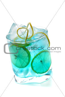 Blue alcohol cocktail with lemon slices