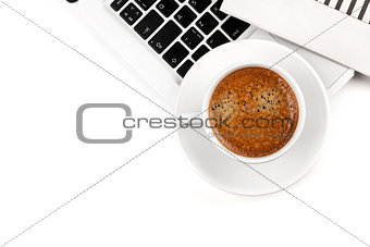 Cappuccino cup on laptop. Above view