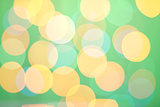 Abstract sunny bokeh on green