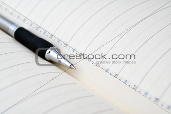 Agenda and pencil